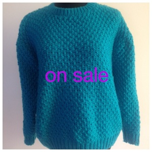Turquoise Sweater in waffle stitch. Size 10-14 for fit. Was $25 now $17.50